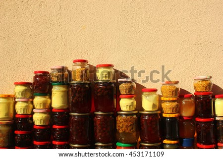 Glass jars with honey and traditional home-made pine cones jam in Borjomi, Georgia