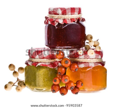 Glass jars with jam isolated white background. - stock photo