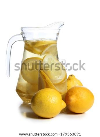 Glass jars with lemon juice on a white background - stock photo
