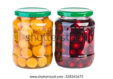 Glass jars with preserved cherries and apricots isolated on white background - stock photo