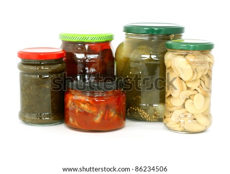 glass jars with tinned products isolated on white background - stock photo