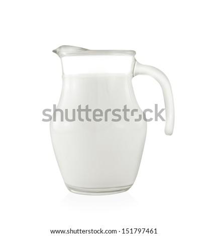 Glass jug of fresh milk on white background - stock photo