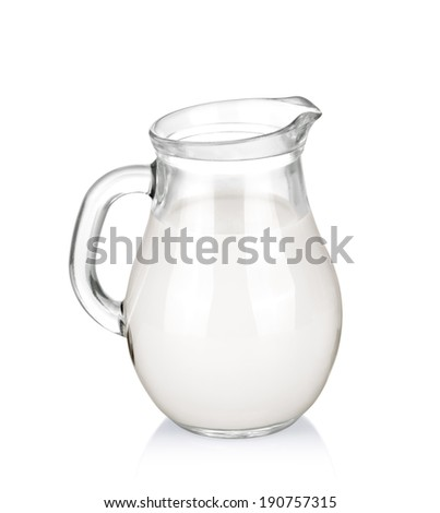 Glass jug of milk isolated on white background.