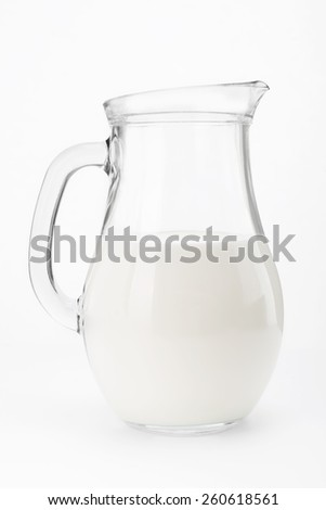 Glass jug pitcher of fresh milk isolated on white background - stock photo