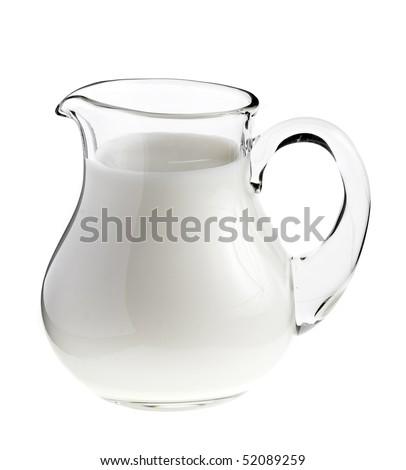 Glass jug pitcher of fresh milk isolated on white background - stock photo