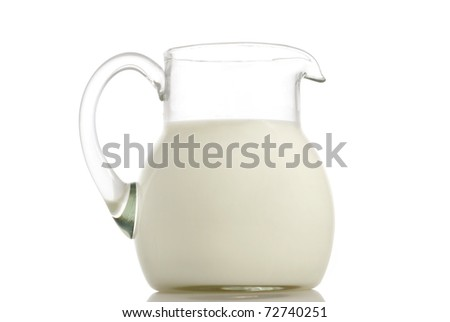 Glass jug with milk on white background - stock photo