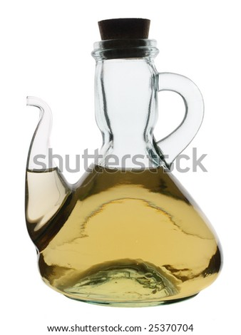 Glass jug with pouring neck, filled with white wine vinegar, backlit and isolated on white