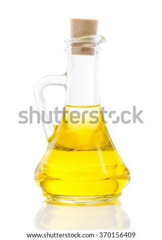 Glass jug with vegetable oil, sunflower, sesame, linseed, cedar, olive oil, walnut oil close up isolated on white background - stock photo