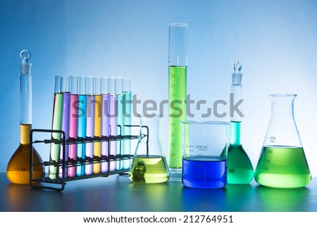 glass laboratory apparatus with color water - stock photo