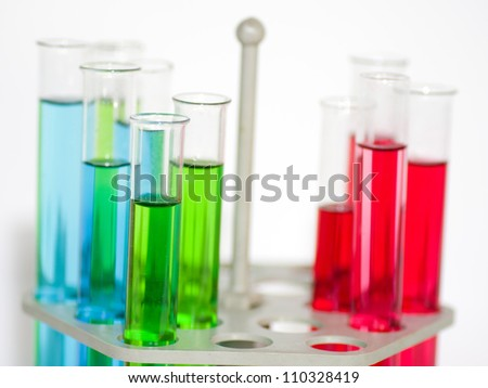 Glass laboratory equipment for science research on white background - stock photo