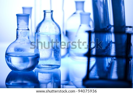 Glass laboratory equipment with blue background
