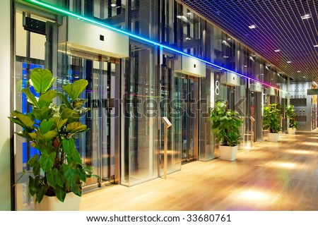Glass lift lobby in a modern shopping center - stock photo