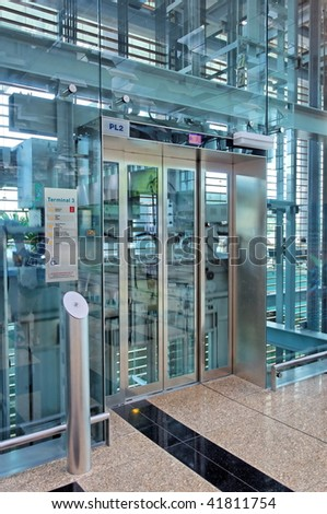 Glass lift lobby in an airport terminal building