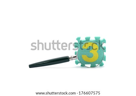 Glass magnifier with block number 3 - stock photo