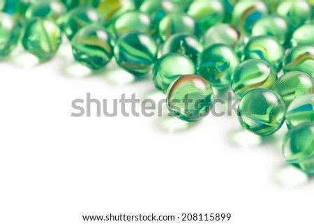 Glass marble balls on white background - stock photo