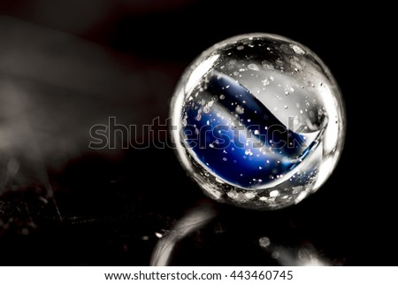 Glass marble - blue color inside macro - stock photo