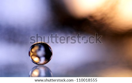 glass marble in blue - stock photo