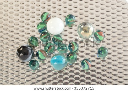 glass marbles balls on stainless steel - stock photo