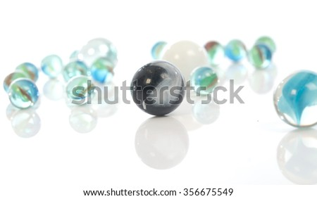 glass marbles balls on white blackground ,selective focus - stock photo