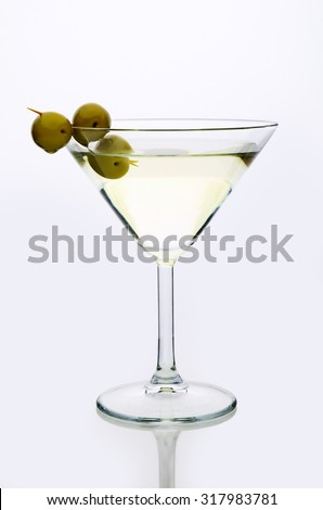 glass martini with olive  light background vertical - stock photo