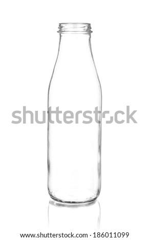 Glass milk bottle isolated on white - stock photo