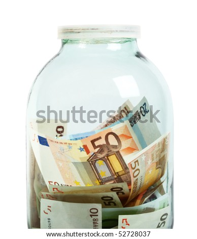 Glass money jar of Euro banknotes