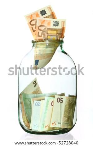 Glass money jar of Euro banknotes - stock photo