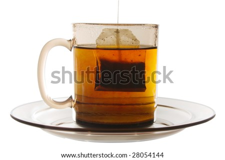 Glass mug of tea with tea bag on white it is isolated - stock photo
