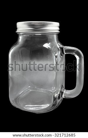 Glass mug with metal lid isolated on black background - stock photo