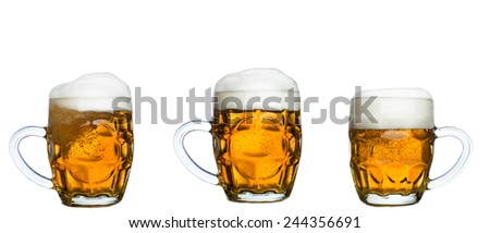 Glass mugs set with beer isolated on white background - stock photo