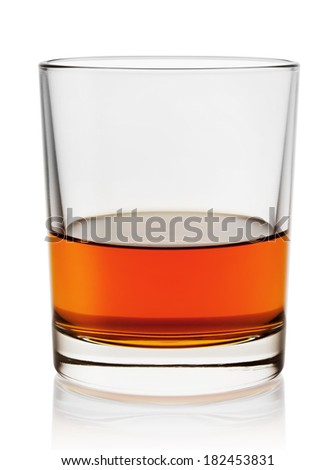 Glass of aged cognac isolated on white background