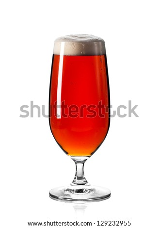 Glass of ale isolated on white background. Focus on stem and sides of glass. Clipping path included. - stock photo
