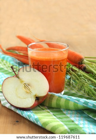 Glass of apple and carrot juice - stock photo