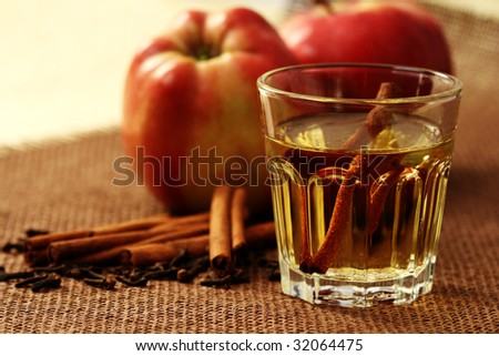 glass of apple juice and some fresh apples