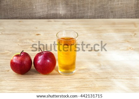 Glass of apple juice on wooden background, closeup, copyspace - stock photo