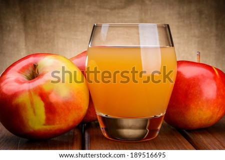 Glass of apple juice with apples - stock photo