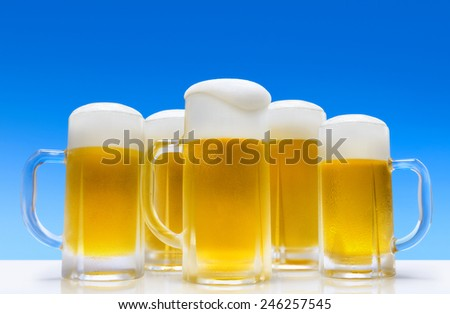 Glass of beer against - stock photo