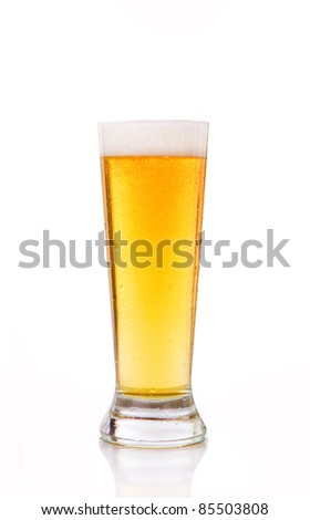 Glass of beer against white background