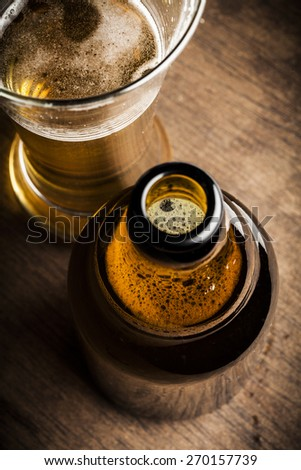 Glass of beer and bottle - stock photo
