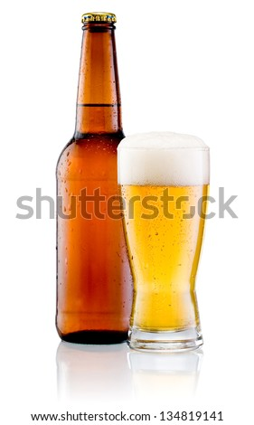 Glass of beer and Brown bottle with drops isolated on a white background - stock photo