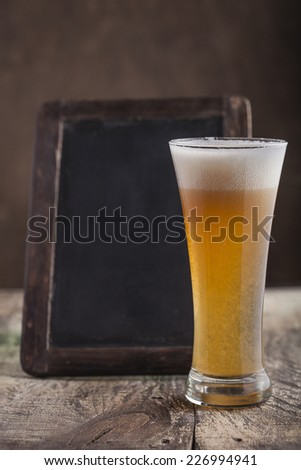 Glass of beer and chalkboard