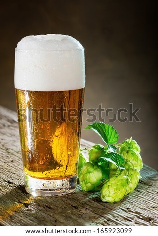 glass of beer and hops