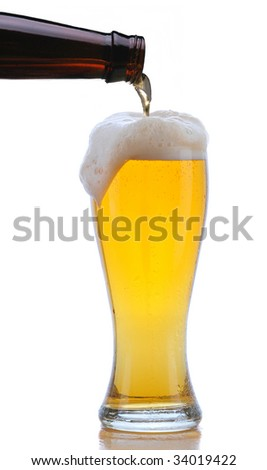 Glass of Beer being Poured from Bottle with Foam Drip and Reflection isolated on white - stock photo