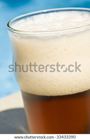 Glass of Beer by the Swimming Pool