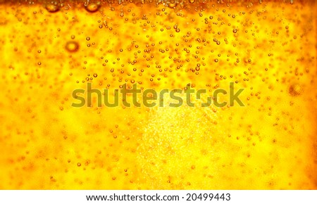 Glass of beer close-up with bubbles - stock photo