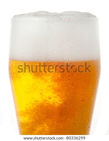 Glass of beer close-up with froth over white background - stock photo