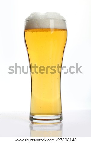 Glass of beer closeup on a white background - stock photo