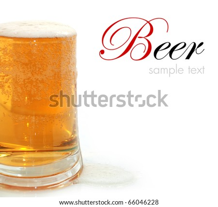 Glass of beer closeup with froth - stock photo