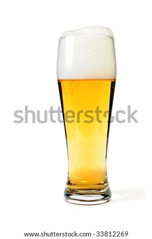 Glass of beer closeup with froth over white background