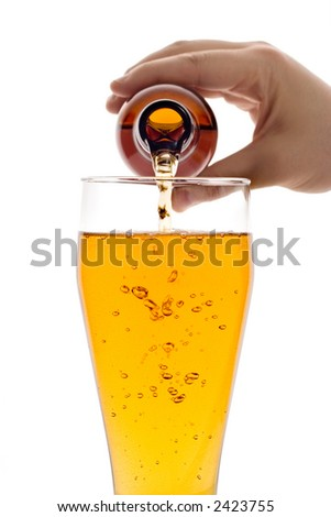 Glass of beer isolated against white background